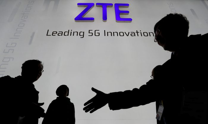 Visitors pass in front of the Chinese telecoms equipment firm ZTE, at the Mobile World Congress in Barcelona, Spain, on February 26, 2018. (Yves Herman/File Picture/Reuters)