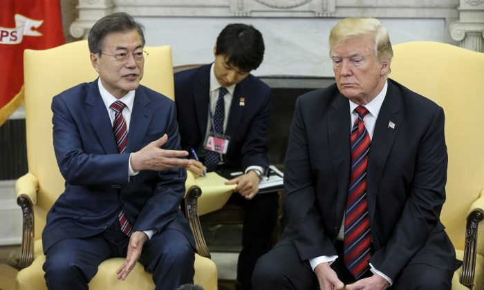 South Korean President Moon Jae-in speaks as President Donald Trump listens during a meeting in the Oval Office of the White House in Washington DC on May 22, 2018. (Oliver Contreras-Pool/Getty Images)