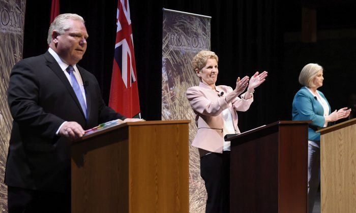 (L-R) Ontario Progressive Conservative Leader Doug Ford, Ontario Liberal Leader Kathleen Wynne, and Ontario NDP Leader Andrea Horwath during the second leaders' debate in Parry Sound, Ont., on May 11. Polls suggest the NDP and PC are tied for the most support in the Ontario election. (The Canadian Press/Nathan Denette)