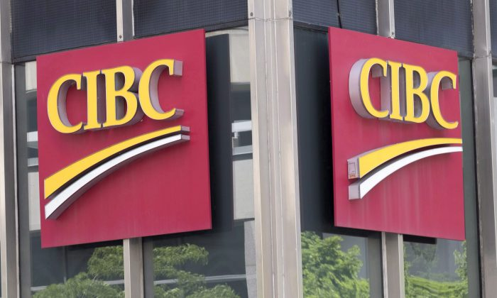 CIBC's mortgage book isn't growing as fast as it did last year thanks to tighter underwriting standards on uninsured mortgages. (The Canadian Press/Paul Chiasson)