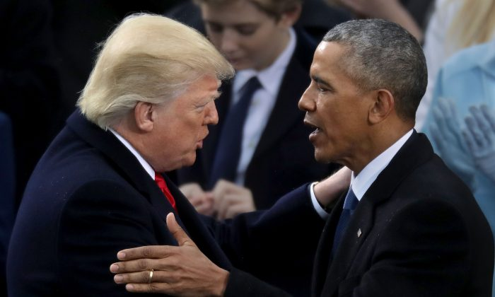 Former U.S. President Barack Obama congratulates President Donald Trump after the latter took the oath of office at the Capitol in Washington on Jan. 20, 2017. (Chip Somodevilla/Getty Images)