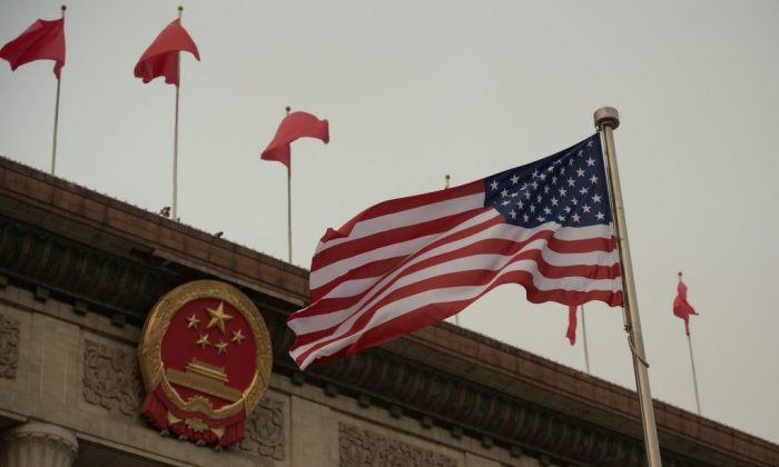 The US flag is seen ahead of a welcome ceremony with US President Donald Trump and Chinese President Xi Jinping outside the Great Hall of the People in Beijing on Nov. 9, 2017. (Photo credit should read NICOLAS ASFOURI/AFP/Getty Images)