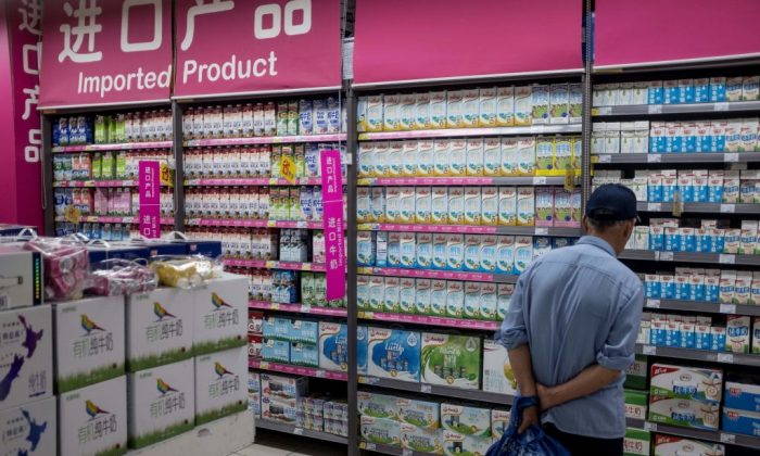 A man looks at imported products at a supermarket in Shanghai on April 11, 2018.  (Johannes Eisele/AFP/Getty Images)