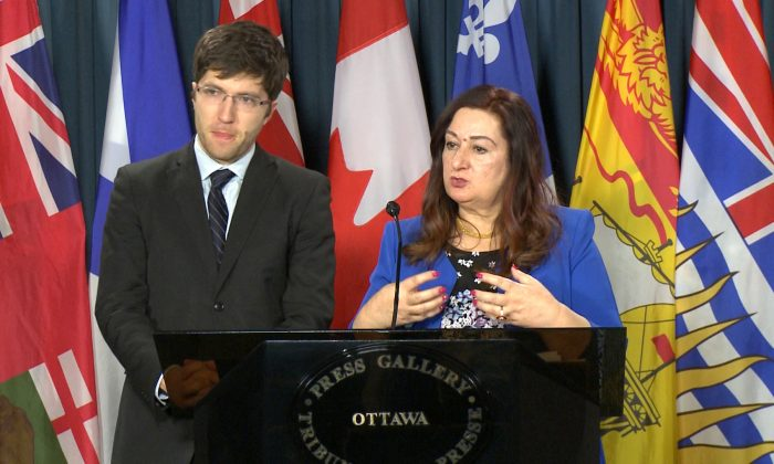 Sen. Salma Ataullahjan speaks about her bill to combat organ trafficking while MP Garnett Genuis looks on at a Parliament Hill press conference in Ottawa on Dec. 12, 2017. (Limin Zhou/The Epoch Times)