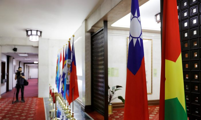 Flags of Taiwan and Burkina Faso (R) are seen inside Taiwan's Ministry of Foreign Affairs in Taipei, Taiwan on May 24, 2018. (Tyrone Siu/Reuters)