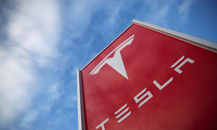 A Tesla dealership is seen in West Drayton, just outside London, Britain, Feb. 7, 2018. (REUTERS/Hannah McKay/File Photo)
