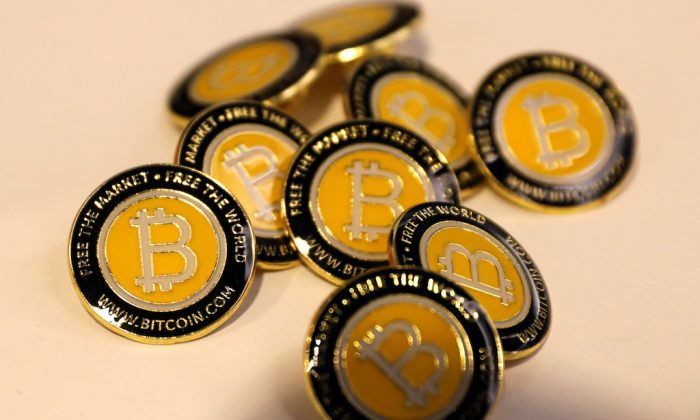 Bitcoin.com buttons are seen displayed on the floor of the Consensus 2018 blockchain technology conference in New York City, New York  May 16, 2018. (REUTERS/Mike Segar)