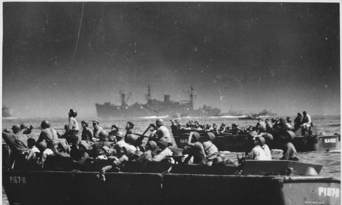 Landing barges carry U.S. troops to Leyte Island in October 1944, during the war in the Pacific of World War II. (U.S. Coast Guard)