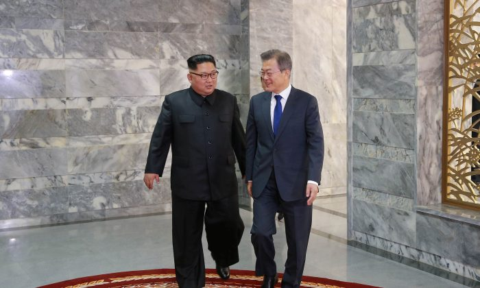 South Korean President Moon Jae-In meets with North Korean leader Kim Jong-un during their summit at the truce village of Panmunjom, North Korea, in this handout picture released by North Korea's Korean Central News Agency on May 27, 2018. (KCNA/via Reuters)
