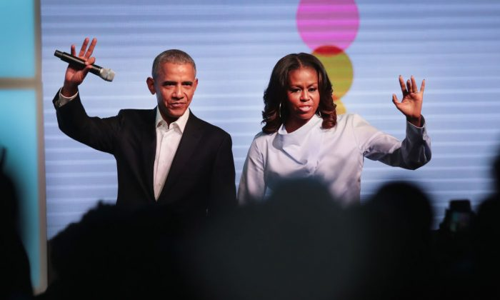 Former president Barack Obama and first lady Michelle Obama greet guests at the inaugural Obama Foundation Summit on Oct. 31, 2017 in Chicago, Illinois. (Scott Olson/Getty Images)