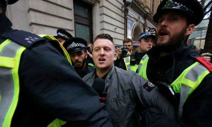 Stephen Christopher Yaxley-Lennon, AKA Tommy Robinson, former leader of the EDL (English Defence League) is escorted away by police in central London on April 1, 2017 following the deadly terror attack against the British Parliament on March 22. (Daniel Leal-Olivas/AFP/Getty Images)