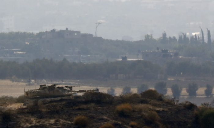 An Israeli army tank keeps position on a hill overlooking the Gaza Strip on May 29, 2018 along the border between Israel and the coastal Palestinian enclave. (Jack Guez/AFP/Getty Images)