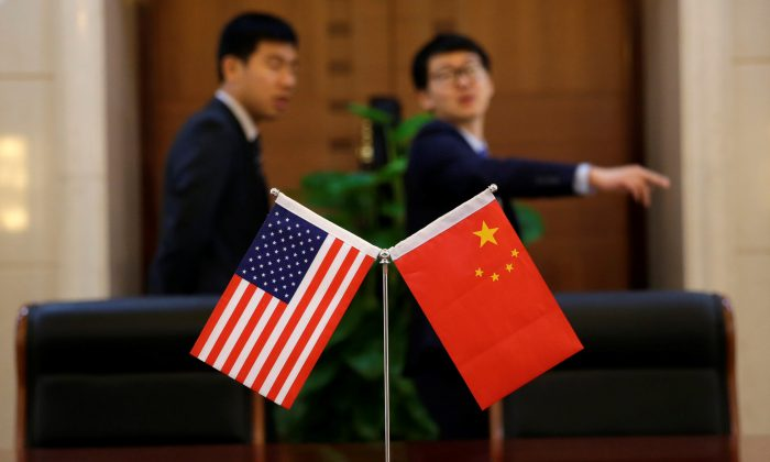 Chinese and U.S. flags are set up at China's Ministry of Transport in Beijing, China on April 27, 2018. (Jason Lee/Reuters)