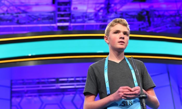 May 29, 2018; National Harbor, MD;      8th grader Pierce Bryner from Utah spelled the word alluvium correctly  during the 2018 Scripps National Spelling Bee at the Gaylord National Resort and Convention Center. (Jack Gruber-USA TODAY NETWORK)
