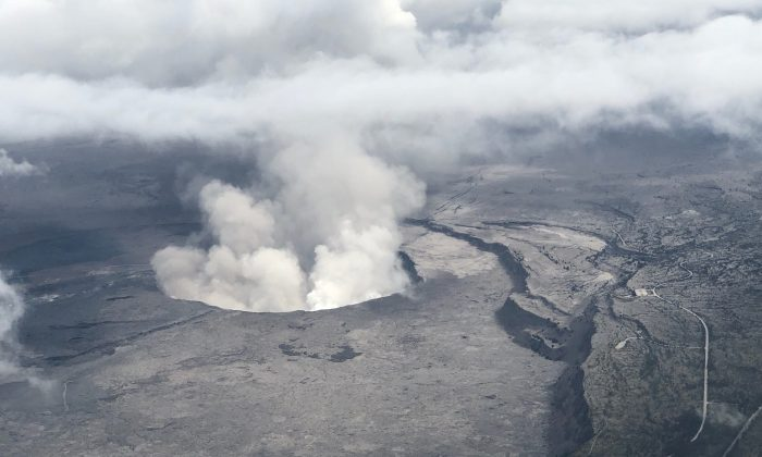An aerial view of Kilauea Volcano's summit caldera and an ash plume billowing from Halema'uma'u, a crater within the caldera, May 27, 2018. (Civil Air Patrol/USGS/Handout via Reuters)