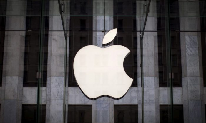 Apple became the first $1 trillion U.S. firm Thursday. An Apple logo hangs above the entrance to the Apple store on 5th Avenue in the Manhattan borough of New York City on July 21, 2015. (Reuters/Mike Segar/File Photo)