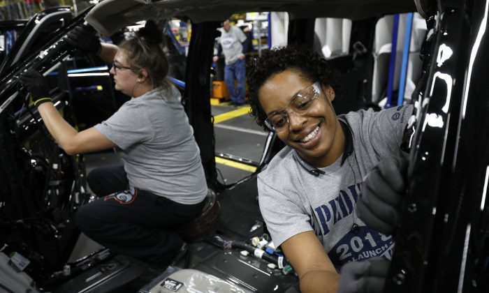 Ford workers Jasmine Powers (R) and Cassie Bell (L) work at the Ford Kentucky Truck Plant in Louisville, Ky., on Oct. 27, 2017.  Many people have a job and are happy with it, but a record amount of Americans is quitting to seek new opportunities. (Bill Pugliano/Getty Images)