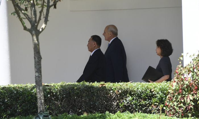 White House Chief of Staff John Kelly (C) walks with North Korean Kim Yong Chol (L) to the White House on June 1, 2018 in Washington. (SAUL LOEB/AFP/Getty Images)