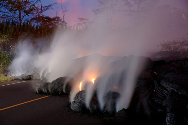 Volcanic gases rise from the Kilauea lava flow that crossed Pohoiki Road near Highway 132, near Pahoa, Hawaii, May 28.