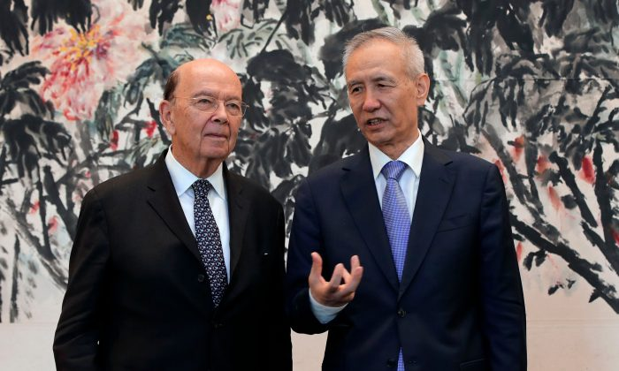 U.S. Commerce Sec. Wilbur Ross (L) chats with Chinese Vice Premier Liu He after their trade meeting in Beijing on June 3. (Andy Wong/AFP/Getty Images)