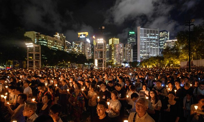 People hold candles during a vigil in Hong Kong on June 4, 2018, to mark the 29th anniversary of the 1989 Tiananmen crackdown in Beijing. (Anthony Wallace/AFP)