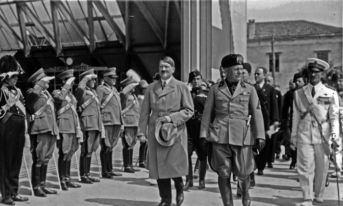 Adolf Hitler and Benito Mussolini walk in front of soldiers in Venice, Italy, in June 1934. (Istituto Nazionale Luce)