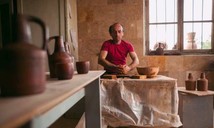 Potter Vahagn Hambardzumyan in his workshop in Sisian, Armenia. He and his wife Zara are bringing their Sisian Ceramics family operation to Washington for the festival. (Narek Harutyunyan/Smithsonian Institution)
