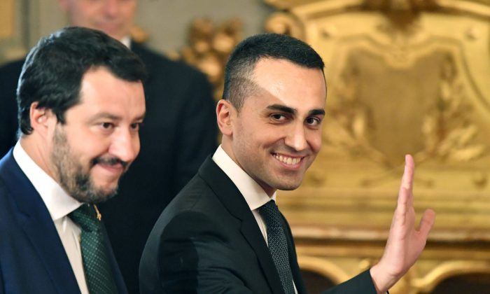 Italy's Labor and Industry Minister and deputy Prime Minister Luigi Di Maio (R) waves as he arrives with Italy's Interior Minister and deputy Prime Minister Matteo Salvini for the swearing in ceremony of the new government at Quirinale Palace in Rome on June 1, 2018 (ALBERTO PIZZOLI/AFP/Getty Images)