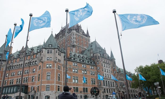U.N. flags fly in front of the Fairmont Le Chateau Frontenac in Quebec City on June 5.  (ALICE CHICHE/AFP/Getty Images)
