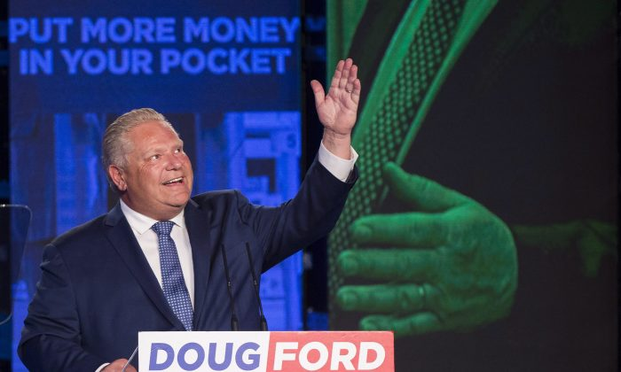 Ontario PC leader Doug Ford looks up and acknowledges his late brother Rob Ford after winning the Ontario Provincial election to become the new premier in Toronto on June 7, 2018. (The Canadian Press/Nathan Denette)