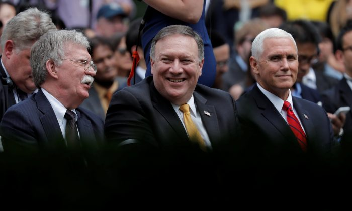 U.S. Secretary of State Mike Pompeo awaits the start of a joint news conference by U.S. President Donald Trump and Japan's Prime Minister Shinzo Abe as he sits between National Security Advisor John Bolton and Vice President Mike Pence in the Rose Garden of the White House in Washington, on June 7, 2018. (Reuters/Carlos Barria)