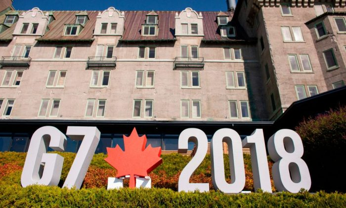 A sign sits in front of the Manoir Richelieu, the site of the G7 leaders summit in La Malbaie, Quebec, June 8. (GEOFF ROBINS/AFP/Getty Images)