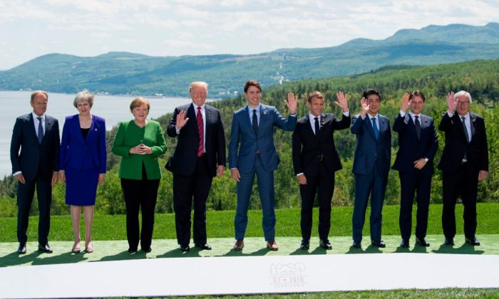 (L-R) The President of the European Council Donald Tusk, British Prime Minister Theresa May, German Chancellor Angela Merkel, U.S. President Donald Trump, Canadian Prime Minister Justin Trudeau, French President Emmanuel Macron, Japanese Prime Minister Shinzo Abe, Italian Prime Minister Giuseppe Conte, and the President of the European Commission Jean-Claude Juncker pose for a family photo during the G7 Summit in La Malbaie, Quebec, Canada, on June 8. (SAUL LOEB/AFP/Getty Images)