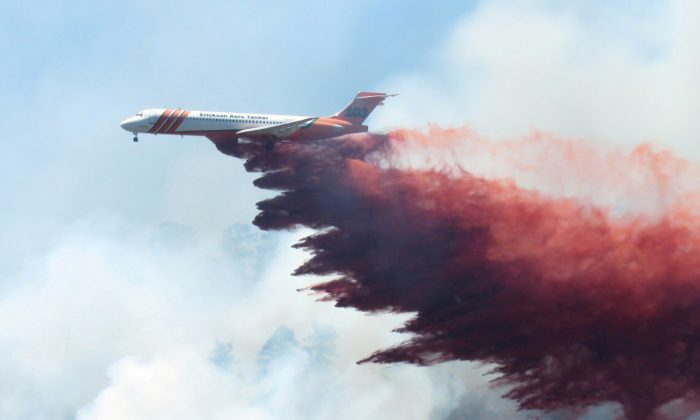 A plane drops fire-retardant chemicals on the 416 Fire near Durango, California, U.S. in this June 9, 2018. (La Plata County/Handout via Reuters)