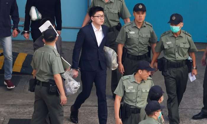 Pro-independence activist Edward Leung walks inside a detention centre before leaving for the High Court for a sentencing hearing in Hong Kong on June 11, 2018. (Bobby Yip/Reuters)