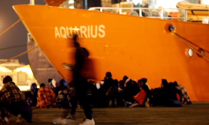 Migrants disembark from the MV Aquarius, a search and rescue ship run in partnership between SOS Mediterranee and Medecins Sans Frontieres, after it arrived in Augusta on the island of Sicily, Italy, Jan. 30, 2018. (Reuters/Antonio Parrinello/File Photo)
