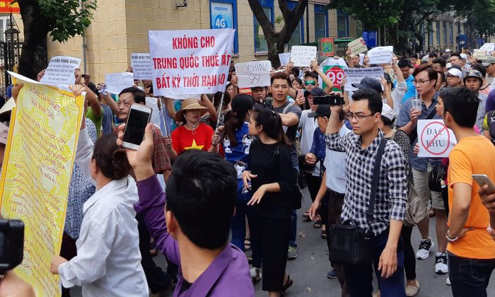 Protesters during a demonstration against a draft legislation on special economic zone in Hanoi, Vietnam on June 10, 2018. Locals are concerned that the land could be leased to Chinese investors. (Staff/Reuters)