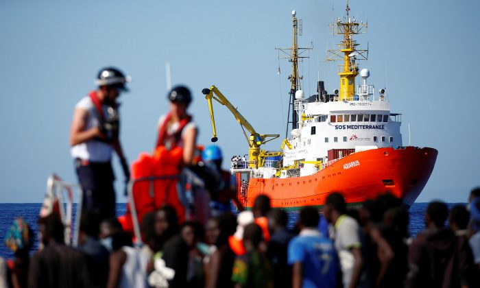 The MV Aquarius rescue ship is seen as migrants on are rescued by the SOS Mediterranee organization during a search and rescue  operation in the Mediterranean Sea, off the Libyan Coast, Sept. 14, 2017. (Reuters/Tony Gentile/File Photo)