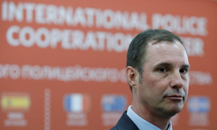 Joseph Stokoe, crime and operations specialist of London's Metropolitan Police, takes part in the opening of the International Police Cooperation Centre ahead of the 2018 FIFA World Cup in Domodedovo near Moscow, Russia, June 12, 2018. (Reuters/Sergei Karpukhin)