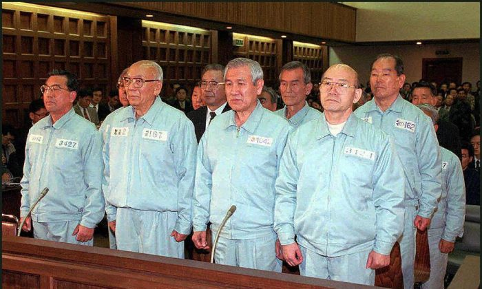 Two former South Korean presidents Chun Doo-Hwan (R) and Roh Tae-Woo (2nd from R) stand trial for their roles in putting down the Gwangju Uprising. (CHOSUN-ILBO/AFP/Getty Images)