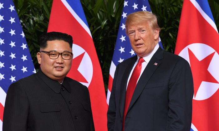 President Donald Trump (R) meets with North Korean  leader Kim Jong Un at the start of their historic summit, at the Capella Hotel on the island of Sentosa, Singapore, on June 12, 2018. (SAUL LOEB/AFP/Getty Images)