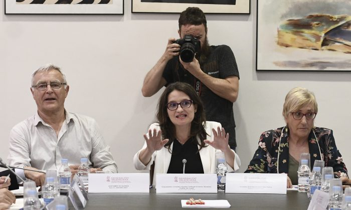 Vice president of Valencia's regional government Monica Oltra (C), mayor of Valencia Joan Ribo, and health counselor Ana Barcelo attend a meeting to organize the arrival of hundreds of migrants stranded for days on the French NGO's ship Aquarius in Valencia, on June 12, 2018. (Jose Jordan/AFP/Getty Images)