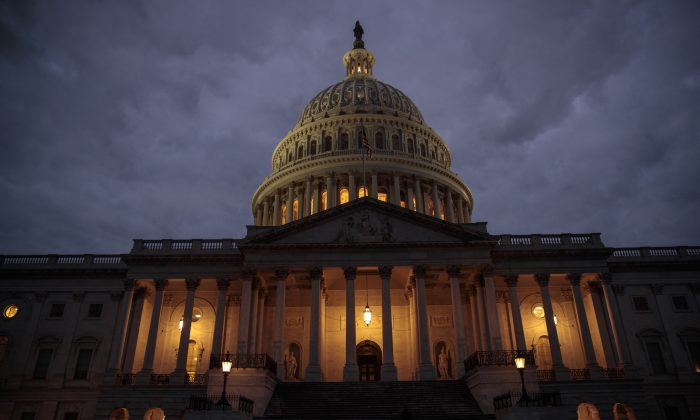 The U.S. Capitol is seen at dusk in Washington, DC. on Jan. 21, 2018. (Drew Angerer/Getty Images)