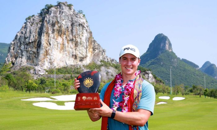 Charlie Saxon of America displays the PGA Tour - Guilin Championship trophy, which he won on June 10. (PGA Tour Series-China / Zhuang Liu)