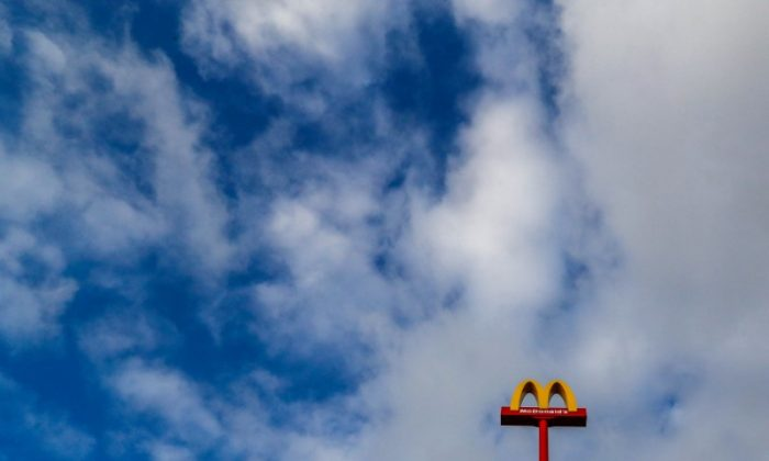 A sign for the U.S. fast food restaurant chain McDonald's is seen outside one of their restaurants in Sint-Pieters-Leeuw, near Brussels, Belgium Nov. 29, 2017. (REUTERS/Yves Herman)