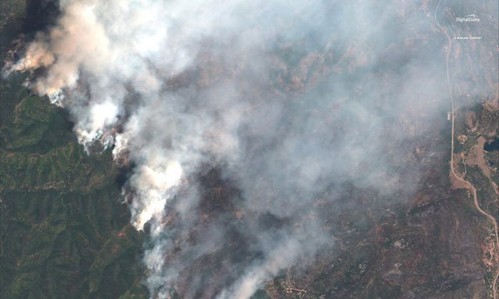 A satellite image shows the 416 Wildfire burning west of Highway 550 and northwest of Hermosa, Colorado, on June 10, 2018.  (Handout via REUTERS)