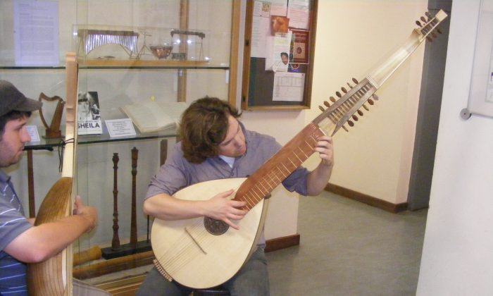Musical instrument maker Alex Potter playing his reconstructed 17th- century ceterone, after his Masters degree in 2013. (Courtesy of Alex Potter)