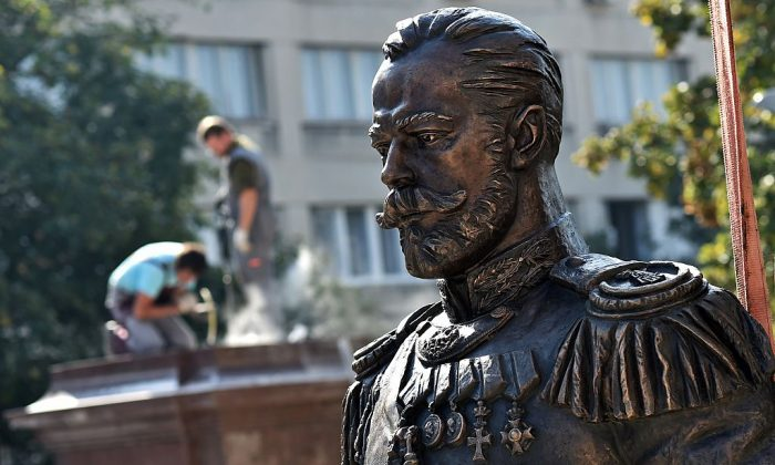 Workers prepare the plinth (L), where the monument of the last Russian Emperor, Czar Nicholas II, will be placed in Belgrade on October 13, 2014. While czarist rule over Russia ended in 1917, American administrations have continued to appoint unofficial administrative czars until this day. (ANDREJ ISAKOVIC/AFP/Getty Images)