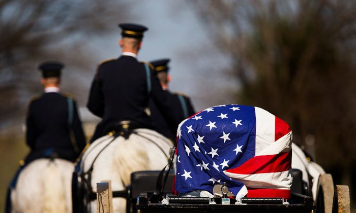 An American flag drapped coffin is taken to a burial at Arlington National Cemetery in Arlington, Virginia on Mar. 7, 2016. (Photo credit should read JIM WATSON/AFP/Getty Images)