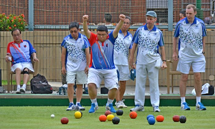 Kowloon Bowling Green Club bowler Musa Karamdin got excited with a great shot delivered by his skipper Ye Sui Ying (not in photo) at the Premier League Division 1 match last weekend, June 9. at the Hong Kong Football Club.   His joy was short lived as the KBGC team came out as the losing side after the final end. (Stephanie Worth)